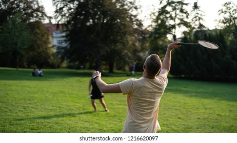 Summer outdoor badminton at park with firends