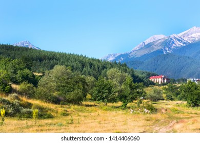 Summer panorama of bulgarian all season resort Bansko, Bulgaria and Pirin mountain peaks