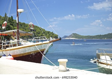Summer Panorama of small Croatian bay and old wooden boat