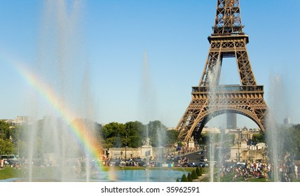 Summer in Paris. Eiffel Tower and rainbow in fountain