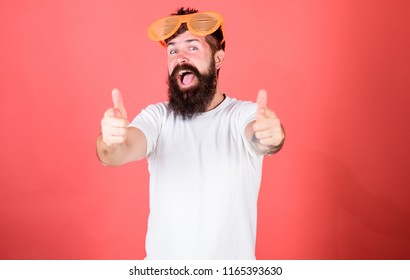Summer party accessory. Summer accessory concept. Sunglasses summer attribute and stylish accessory. Man bearded hipster wears giant louvered sunglasses. Hipster wears shutter shades sunglasses.