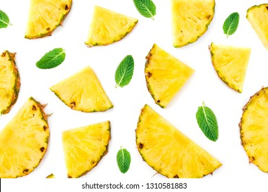 Summer Pattern with  Sliced Pineapple Isolated.  Pineapple pieces  with green mint  leaves on white background. Flat lay.
