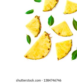 Summer Pattern with Slices of Pineapple Isolated. Exotic fruit Pineapple pieces with green mint leaves on white background. Flat lay.