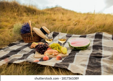 Summer peknik in nature in the mountains. fruits at the picnic. Grocery grapes Vienna.