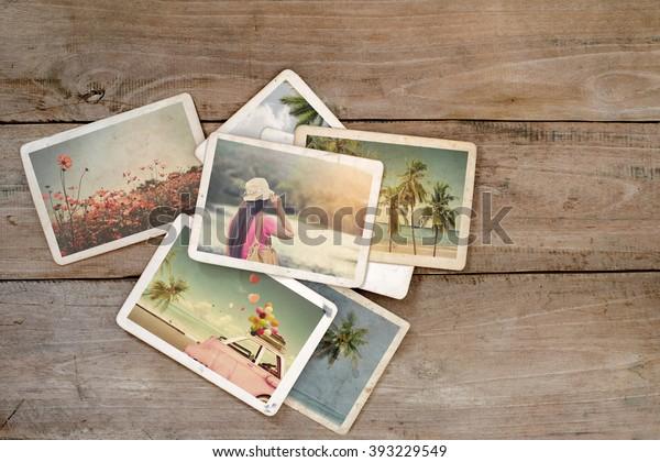 Летний фотоальбом памяти и ностальгии на деревянном столе. Мгновенное фото кинокамеры - винтажный и ретро стиль