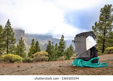 Summer photo of backpack in mountains and free space for your decoration.