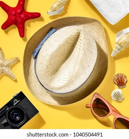 Summer photo of travel tools on yellow background and free space for your decoration.