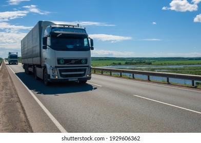 summer photography, trucks driving, river bridge over the river, Russia Tatarstan Menzilinsk 2019 06 25