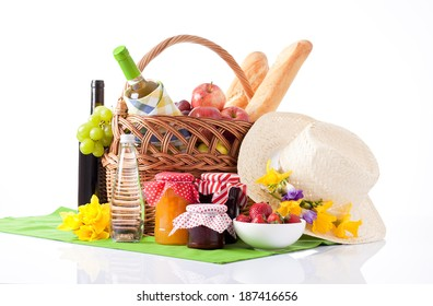 Summer picnic with a basket of food