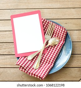 Summer Picnic Outdoor Table Placesetting with Red White and Blue Colors with fork and spoon with a Blank Card for your words, text, copy or design.  A flat lay and square crop from top down view