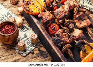 Summer picnic with shashlik and lotto board game.Barbecue and board games.Kebab.Picnic concept