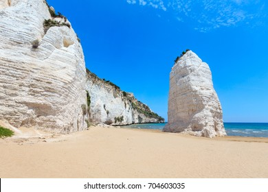 Summer picturesque Beach of Pizzomunno famous white rock, in Vieste, Gargano coast, Puglia, Italy
