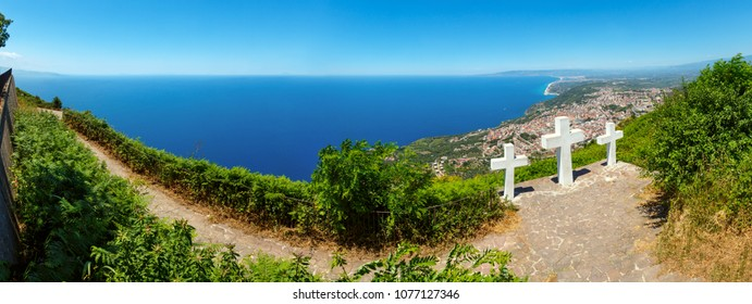 Summer picturesque Tyrrhenian sea Calabrian coast view from Monte Sant Elia (Saint Elia mount, Calabria, Italy). Three Christianity crosses on mountain top. Three shots stitch high-resolution panorama
