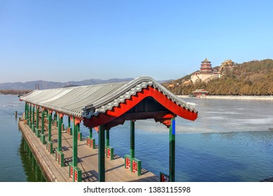Summer Place nearby Beijing, China, featuring a boat dock and the Longevity Hill across the Kunming Lake.