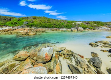 Summer popular destination in Australia. William Bay National Park in Denmark region, Western Australia. Tropical turquoise clear waters of Madfish Beach surrounded by rock formations. Blue sky.