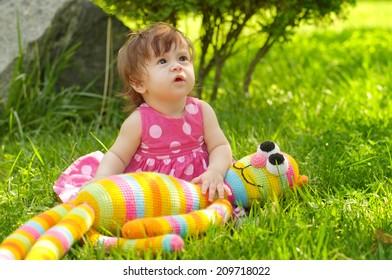 Summer portrait of beautiful baby girl