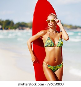 Summer portrait of beautiful blonde woman on the beach