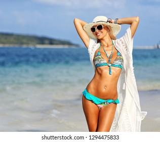 Summer portrait of happy beautiful woman on the sea