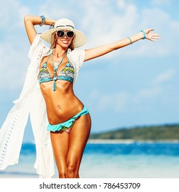 Summer portrait of happy beautiful woman enjoying freedom