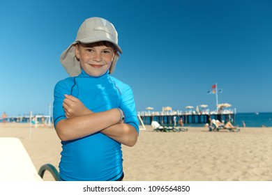 Summer portrait on the beach of happy little boy.