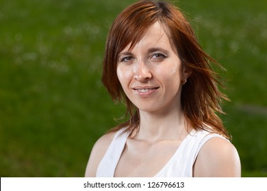 Summer portrait of a young lady outdoors - shallow DOF, focus on eyes