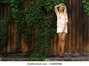 summer portrait of young pretty cute blonde girl