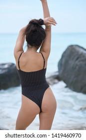 summer portrait of young pretty woman in bikini near the sea at tropical beach. Outdoor summer portrait of young pretty woman in bikini near the sea