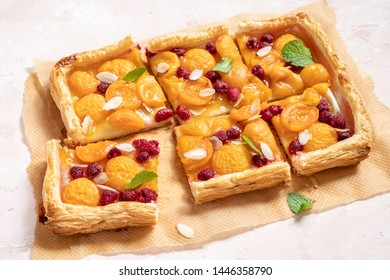Summer puff pastry tart with apricots and raspberry