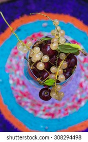 Summer punch with white currant berries and cherries. Top view and colorful background.