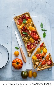 Summer quiche with heirloom tomatoes and basil
