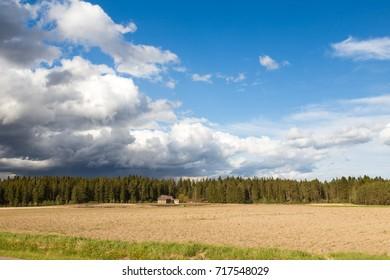 Summer Rain Approaching Dry Farmland