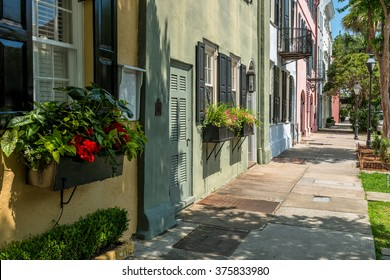 Summer at Rainbow Row - Rainbow Row, a series of colorful and well-preserved historic Georgian row houses on East Bay street, one of most popular tourist attractions in Charleston, South Carolina, USA