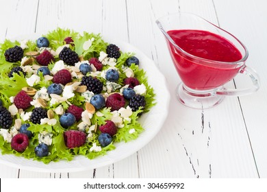 Summer refreshing mixed berry salad with pumpkin seeds, blue cheese, feta and sweet red raspberry vinaigrette