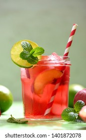 Summer refreshment drink or cocktail, red peach and lime iced tea