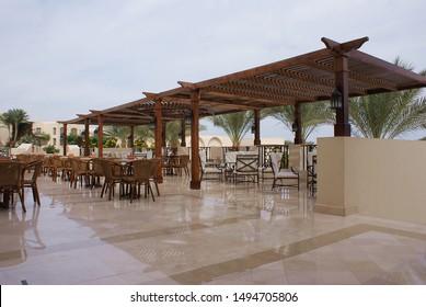 Summer restaurant terrace under the palm trees