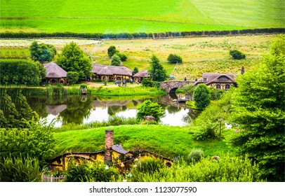 Summer river village in Shire, Hobbiton, New Zealand. Hobbit houses at river in Hobbiton, New Zealand