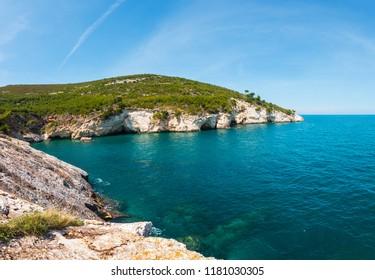 Summer rocky sea coast Baia Di Campi Vieste on the Gargano peninsula, Puglia, Italy