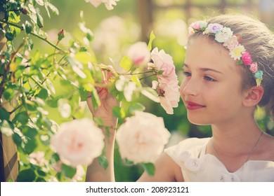 Summer, Rose garden - beautiful girl playing in the rose garden