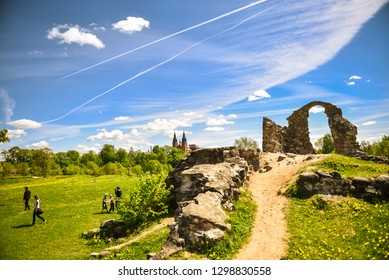 Summer rural environmental landscape.  Ruins of the Rezekne Castle Hill with dramatic sky. Tourists look at urban ruins. Rezekne - Latvia, June, 2017.