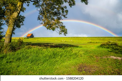 Summer rural house rainbow landscape. Rainbow rural house landscape. Rural house rainbow view. Rainbow rural house scene