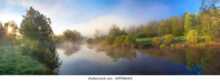 summer rural landscape panorama with river, fog and forest at sunrise