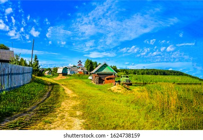 Summer rural village road view. Russian village in summer. Rural village scene in Russia