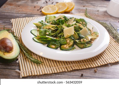Summer salad with , avocado and spinach. White table