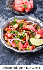 Summer salad with beef meat, watermelon and lime.Exotic food