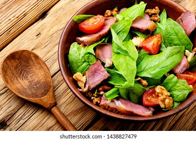 Summer salad with fresh herbs.Salad with spinach,bacon and sorrel