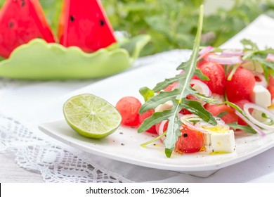 Summer salad with watermelon and feta cheese. Selective focus.