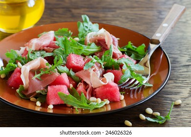 Summer salad with water-melon and prosciutto.