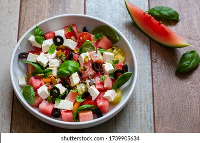 Summer salad with watermelon, tomatoes, feta cheese and basil