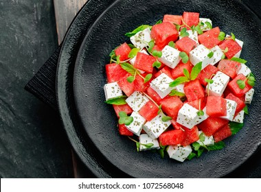 Summer salad of watermelon,feta cheese,fresh mint leaves and micro greens.Top view with copy space.