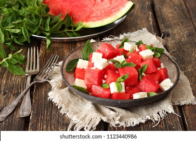 Summer salad of watermelon,feta cheese,fresh mint leaves .